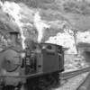 W33 Bembridge is seen at Ventnor on 15/08/64 - in the process of running round her stock - being withdrawn in December 66.