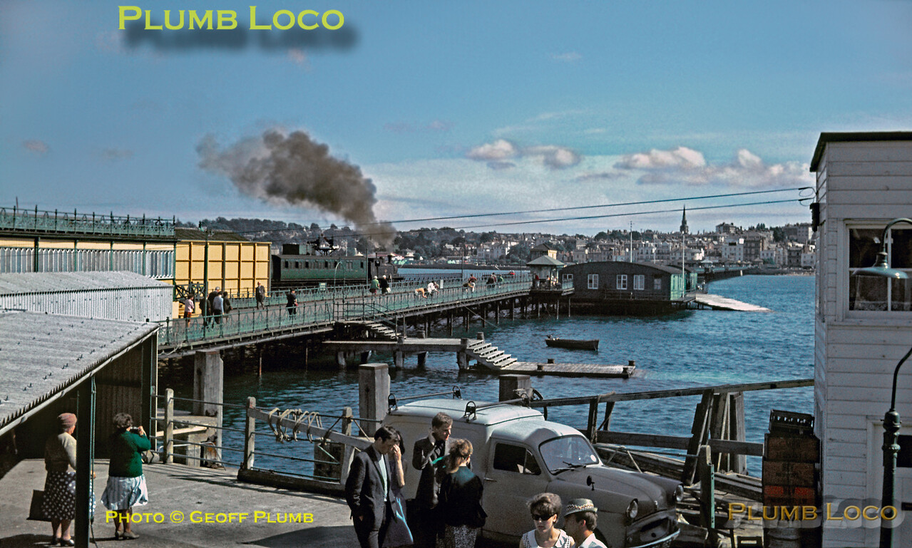 """Seen from the deck of the MV """"Balmoral"""" which had called at Ryde Pier during its round the island trip, O2 0-4-4T No. W33 """"Bembridge"""" is departing from Pier Head station with a train bound for Ventnor. Tuesday 20th July 1965. Slide No. 1444."""