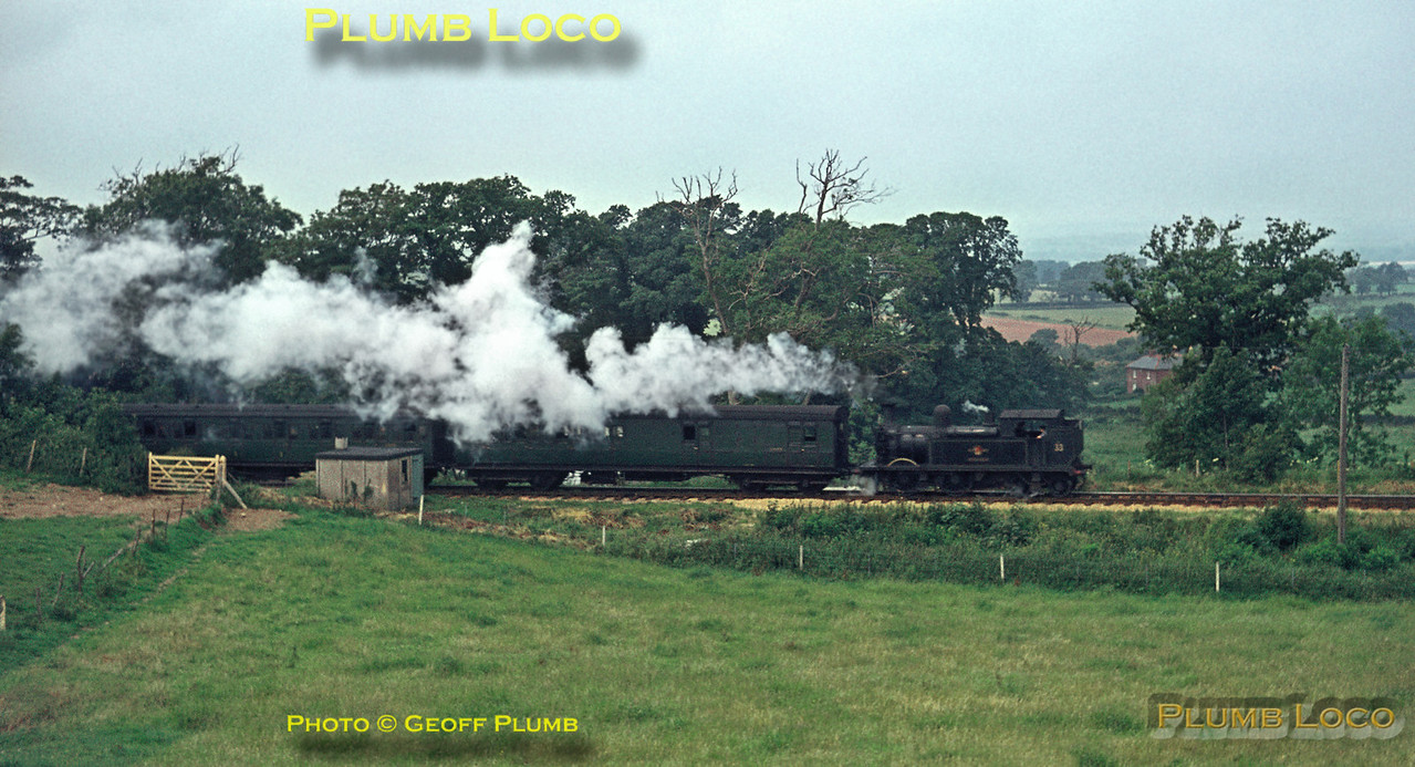 """O2 class 0-4-4T No. W33 """"Bembridge"""" has just departed from Wroxall station with the 12:00 train from Ventnor to Ryde Pier Head, Wednesday 21st July 1965. Slide No. 1455."""