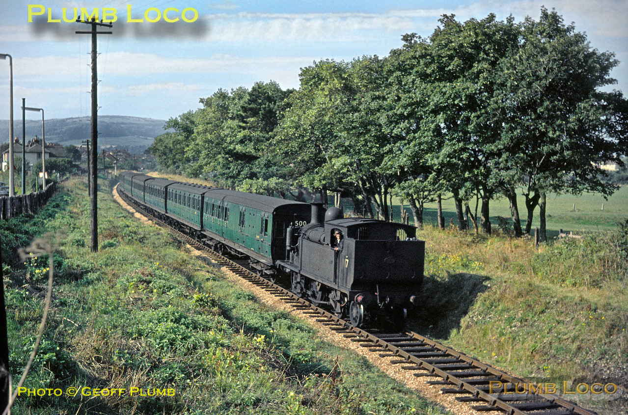 """Seen from the A3055 Sandown Road bridge over the railway, O2 0-4-4T No. W17 """"Seaview"""" is passing the recreation ground on the outskirts of Shanklin as it works the 09:40 train from Ventnor to Ryde Pier Head on Wednesday 2nd September 1964. Slide No. 1002."""