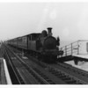 The 15 20 Ryde Pier Head to Shanklin is seen arriving with W32 Bonchurch in charge at Ryde Esplanade on 15/08/64 - being withdrawn 2 months later.