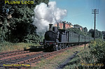 "0-4-4T Class O2 No. W16 ""Ventnor"" has just set off from Brading station on the double track section towards Sandown with the 09:28 Ryde Pier Head to Ventnor train on the lovely morning of Monday 31st August 1964. Note the unfenced public footpath from a local road to the station! Slide No. 999."