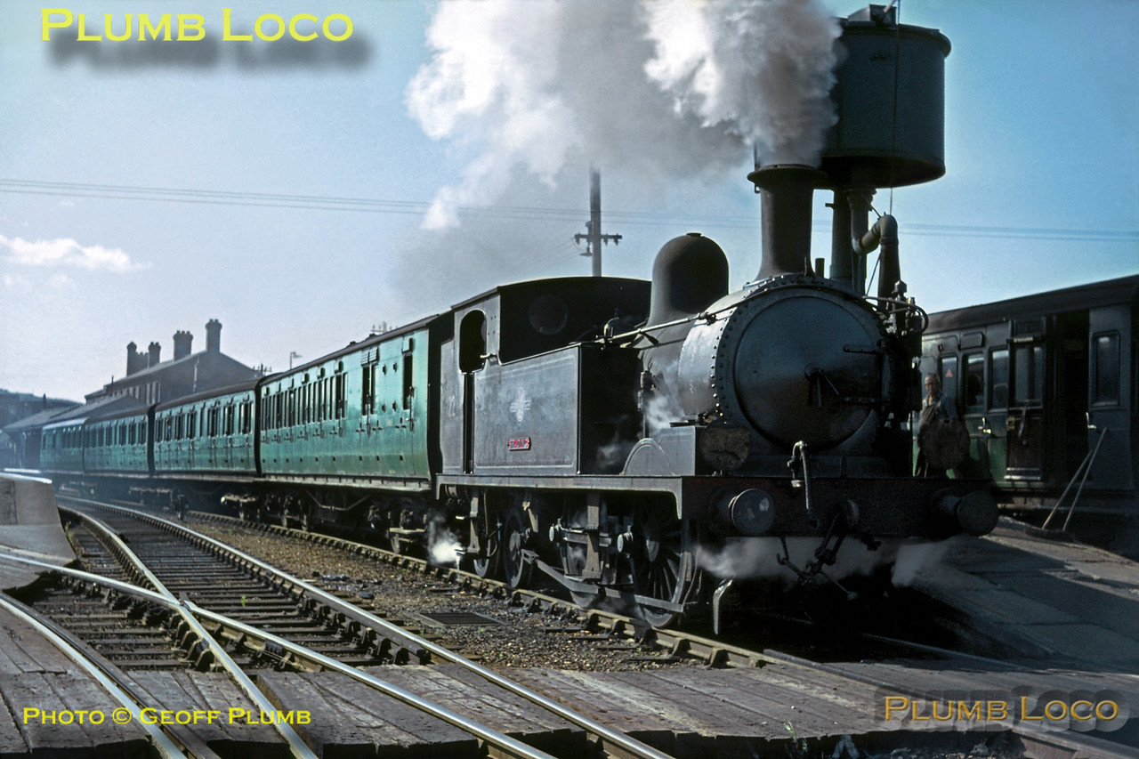 """O2 class 0P 0-4-4T No. W22 """"Brading"""" has the signal """"off"""" and the """"rightaway"""" from the Guard to depart from Newport station with the 09:34 train from Ryde Pier Head to Cowes on Saturday 29th August 1964. Slide No. 1036."""