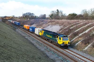 70017 passes Chipping Sodbury with 4O51 09.58 Wentloog to Southampton Freightliner service.  Wednesday 26th February 2014.