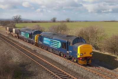 37259 & 37602 with FNA's 550041 & 550038 pass Badgeworth with 6M63 11.58 Bridgwater to Crewe Coal Sidings flask working. Wednesday 26th February 2014.