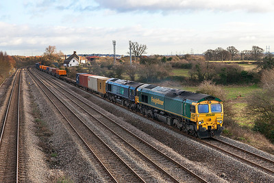running over 4 hours late 66556 & 66416 pass Church Road, Undy with 4V51 03.12 Southampton to Wentloog Freightliner service. Thursday 9th January 2014.