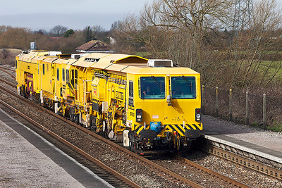 DR77903 'Frank Jones' Ballast Regulator & Dr73115 Tamper pass Pilning working from Maindee Depot to Newbury. Friday 21st February 2014.