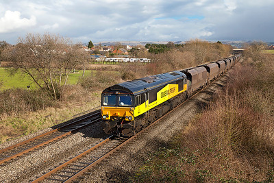66848 passes Badgeworth with 4V30 08.25 Ratcliffe Power Station to Portbury Docks empty coal hoppers. Wednesday 26th February 2014.
