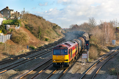 60071 'Ribblehead Viaduct' powers past East Usk with 6M86 09.23 Margam to Dee Marsh via Llanwern loaded steel carriers. Thursday 9th January 2014.