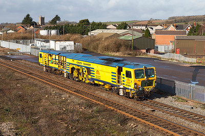 Ex Amey Rail 'Eddie King'  Switch/Crossing Tamper DR73905 now with Colas Rail passes Severn Tunnel Junction working from Hereford to West Ealing Plasser Sidings. Friday 21st February 2014.