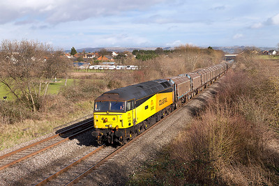 47727 'Rebecca' passes Badgeworth with 6Z47 11.05 Long Marston to Llanwern refurbished JSA covered steel carriers. Wednesday 26th February 2014.