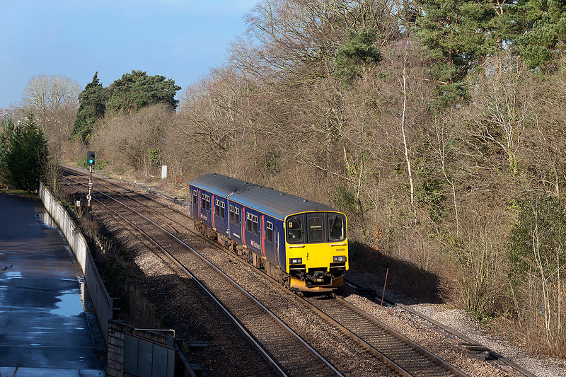 150101 passes Ram Hill forming the 2E18 08.45 Westbury to Gloucester. Wednesday 26th February 2014.