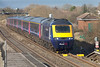 """43034 """"Travel Watch South West' & 43194 have charge of 1L52 1028 Swansea to London Paddington climbing past Pilning. Friday 21st February 2014."""