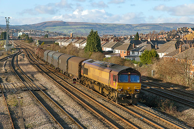 66013 looks as though it was on RHTT duties last autumn as it passes East Usk with 6M41 11.42 Margam to Round Oak loaded steel carriers. Thursday 9th January 2014.
