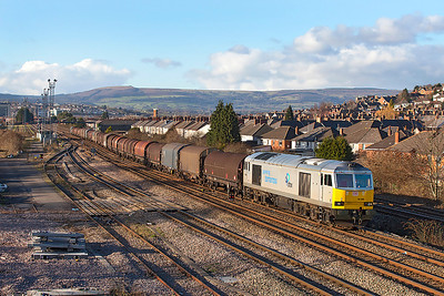 60066 in Drax Biomass livery passes East Usk with 6V75 09.30 Dee Marsh to Margam via Llanwern empty steel carriers. Thursday 9th January 2014.