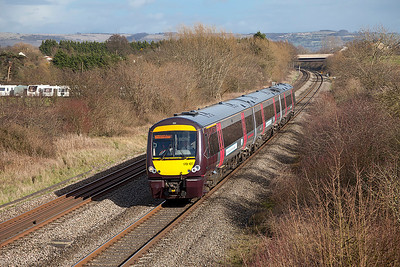 170107 forming the 1V08 11.10 Nottingham to Cardiff Central passes Badgeworth west of Cheltenham Spa. Wednesday 26th February 2014.