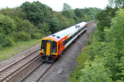 South West Train's 158886 on hire to FGW passes Ram Hill forming the 10.51 Great Malvern to Brighton. 14/07/2011