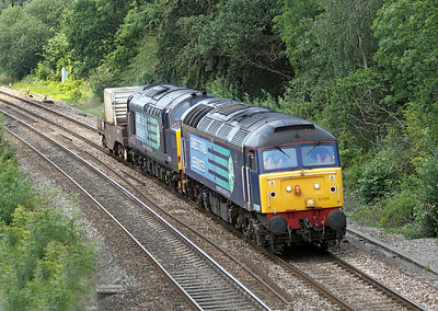 The unusual combination of 57009 & 37229 haul 1 FNA flask wagon past Ram Hill forming the 6M67 Bridgwater to Crewe, running about 1 hour early. 14/07/2011