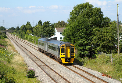 158832 forming the 09.15 Maesteg to Cheltenham Spa passes Portskewett. 14/07/2011