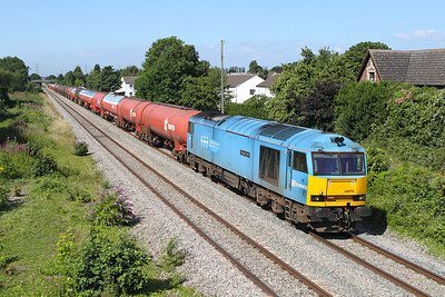 60074 passes the site of Portskewett station with 6B13 05.05 Robeston to Westerleigh loaded Murco tanks. 14/07/2011