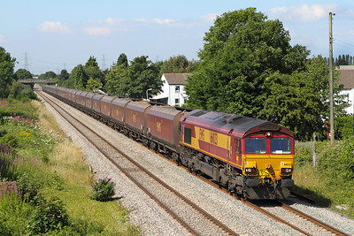 66023 passes the site of Portskewett station with 4E66 08.55 Margam to Redcar empty HTA's. Thursday 14th July 2011.