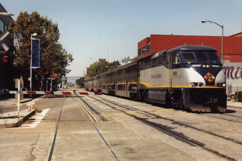 A Capitol Corridor train runs down Embarcadero St. as it approaches the station. The street trackage is about a quarter mile long.
