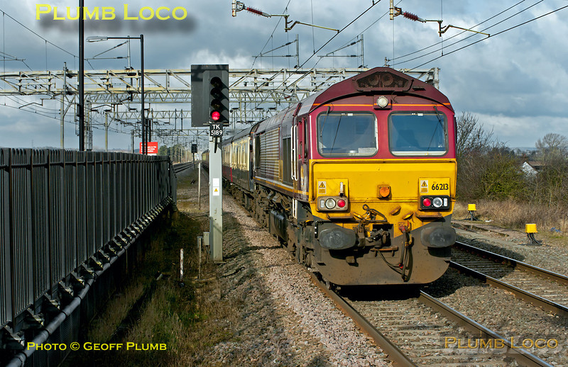 """66200 has passed through Cheddington station topping 1Z77 """"The Concrete Cow"""" railtour with 66213 tailing the train. This was a repeat of the tour run the previous week, starting from Paddington at 07:49 and running via diverse routes to Wolverton. 12:51, Saturday 28th January 2012. Digital Image No. GMPI10865."""