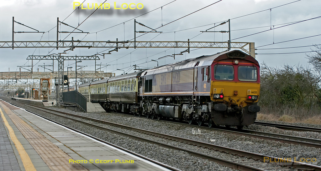 """66085 is topping the train whilst 66213 is on the rear as they pass Cheddington station on the down slow line. This is """"The Concrete Cow"""", 1Z74, 07:49 from Paddington via Southall, Brentford, Colnbrook, West Drayton, Acton Wells to Wembley Yard and Sudbury Junction. The train then continued as 1Z75 to Watford Junction, Milton Keynes and Wolverton Works. Then to Northampton and reverse to Bletchley and across the flyover for another reversal to Fenny Stratford, then Bletchley, Watford Junction and Wembley Central to arrive into Euston at 17:33 - quite a tour! 12:51, Saturday 21st January 2012. Digital Image No. GMPI10838."""