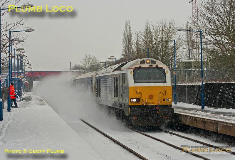 67010 powers through Haddenham & Thame Parkway station in a cloud of blown snow with 1R34, the 13:15 from Marylebone to Birmingham Moor Street, running around seven minutes late at 13:55 on Friday 18th January 2013. Digital Image No. GMPI13766.