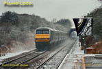 LHCS sets were out of their normal diagrams on Monday 14th January 2013, when the first snowfalls also occurred. 67023 with the blue/grey set was expected to work 1H21, the 07:44 from Banbury to Marylebone, but this was worked by 82301 with 67010 on the rear of a five coach silver set. 67023 worked 1H17, the 07:44 from Princes Risborough to Marylebone and then 1R16, the 08:45 from Marylebone to Birmingham Moor Street, making a rare daylight (almost!) appearance for this set and a rare journey north of Banbury. The train is seen at speed through Haddenham & Thame Parkway station at 09:23, blowing up a small snow cloud, with DVT 82304 on the rear. Digital Image No. GMPI13692.