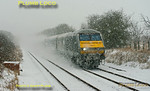 By mid-day on Friday 18th January 2013 the snow had become quite intense and was settling well as DVT 82303 leads 1H44, the 10:55 from Birmingham Moor Street to Marylebone, at Haddenham running one minute early at 11:58. There is a train behind it, with 67013 on the rear, completely hidden by thrown up snow! Digital Image No. GMPI13754.