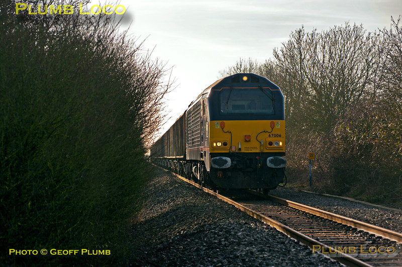 """""""Royal"""" 67 No. 67006 """"Royal Sovereign"""" is once again working 6A49, the 12:10 from Didcot Yard to MoD Bicester trip working, here approaching the bridge under the M40 motorway near Wendlebury, south of Bicester at 13:10 on Wednesday 9th January 2013. Photo taken from a public fotpath across the line. Digital Image No. GMPI13621."""