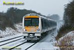 A four-car unit consisting of 172 101 and 172 102 approaches Haddenham & Thame Parkway station with 1H54, the 13:58 from Biciester North to Marylebone, arriving slightly early at 14:08 in the snow on Friday 18th January 2013. Digital Image No. GMPI13773.