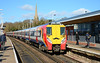 SWT Juniper 458015 complete with its moustache from the month of Movember, arrives at Wokingham with service 2C36, the 12:25 to London Waterloo 27/02/2015.