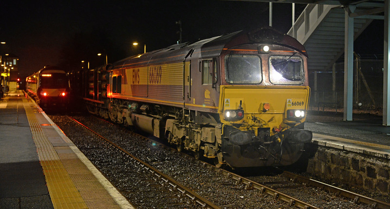 66069 runs through Dyce Station on 5th January with pipes from Tees Yard to Raith's Farm