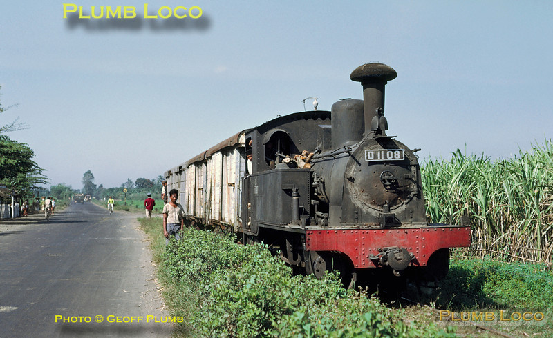 Java. D11 08 is an 0-8-0T, built by Hohenzollern, No. 4088 of 1921. The whole class of eleven engines was based at Malang depot in East Java and this loco is seen near Gadang, around 7Kms from Malang, working along the branch from Dampit, though the line seemed to be disused beyond Krebet. Note the smokebox door has a sort of mud poultice around it to keep it airtight! Thursday 26th July 1973. Slide No. 11891.