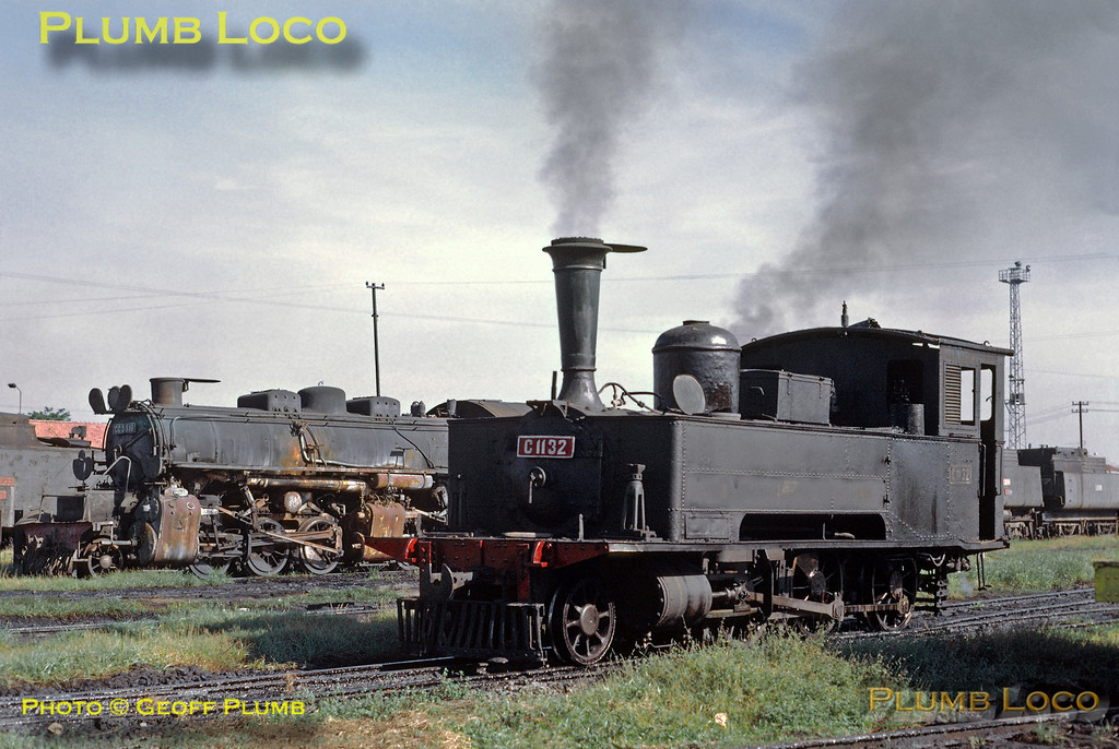 C11 class 2-6-0T No. C11 32 (Hartmann No.1718 of 1891) is shed pilot at Sidotopo depot in Surabaja and looks in quite good nick for its age. Amongst several dumped engines in the background is CC50 class 2-6-6-0 Mallet No. CC50 16 (SLM No. 3218 of 1927), probably never to turn a wheel again. Sunday 29th July 1973. Slide No. 12066.