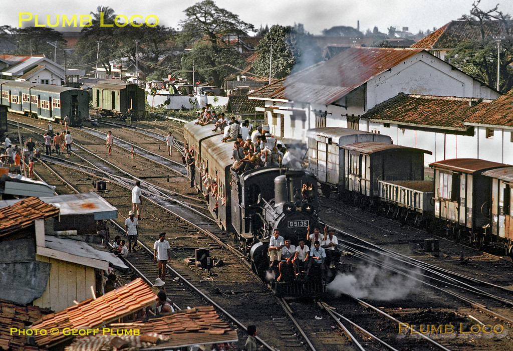 B51 class 4-4-0 No. B51 35 departs from Tanahabang station with a rather overloaded passenger train to Rangkasbetung on the late afternoon of Tuesday 17th July 1973. The two coaches looked as though they might not last the length of the journey, so perhaps it was preferable to sit outside! Slide No. 11178.