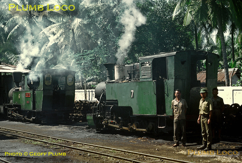 "This was the first sugar mill line we came across - the Kalibagor Mill at Sokaraja. This was the loco depot on the 700mm gauge system and locos Nos. 6 & 7 are on shed. Both are apparently in steam, but both have their dome covers removed (for maintenance?) and No. 7's valve gear is also stripped down! No. 7 was at some stage of its career named ""Jaya Latu"" and is an 0-8-0T built by Maffei, Works No. 3784/1913. No. 6 is also an 0-8-0T named ""Baletoeri"", built by Orenstein & Koppel, 9359/1920. This mill system closed in 1997, though both these engines moved on to Gondang Baru. Saturday 21st July 1973. Slide No. 11511."
