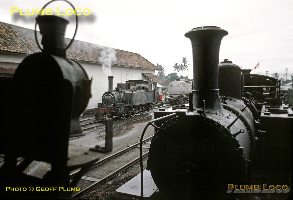 At a rather damp Tasikmalaja loco depot, 2-4-0T No. B13 03 is raising steam in the background while Mallet 0-4-4-2T No. BB10 09 sits dumped out of use in the foreground. B13 03 was built by Hanomag, works number1857 of 1885, BB10 09 was built by Hartmann, No. 3089 of 1906. Friday 20th July 1973. Slide No. 11355.
