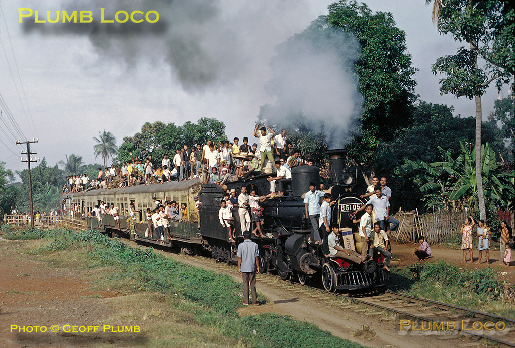 PNKA 4-4-0 No. B51 05 is in charge of the 07:18 train from Rangkasbetung to Tanahabang - its two coach train plus van rather overloaded! It is departing from Kebajoran station at 08:30 on Friday 3rd August 1973 with rather a lot of passengers and their baggage - quite how they got on the roof with all their stuff is something of a mystery! B51 05 was built by Hanomag in 1900, works No. 3362. Slide No. 12304.
