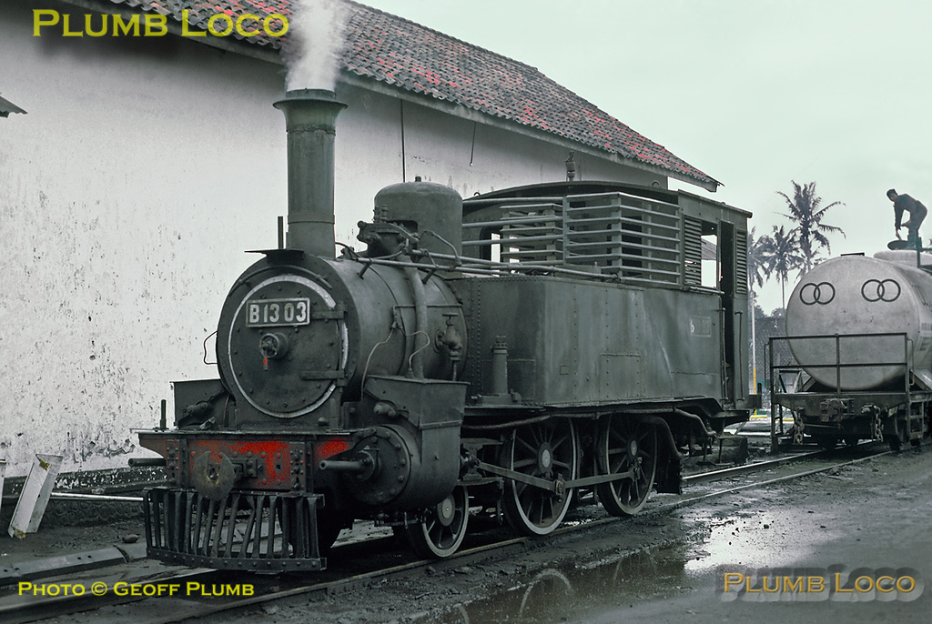 Looking rather reminiscent of the Isle of Man 2-4-0Ts, PNKA B13 class No. B13 03 simmers in the yard at Tasikmalaja depot on Friday 20th July 1973. This was one of eleven locos built by Hanomag in 1885, works numbers 1855-1865, quite what it would be in steam for is unknown... Slide No. 11338.