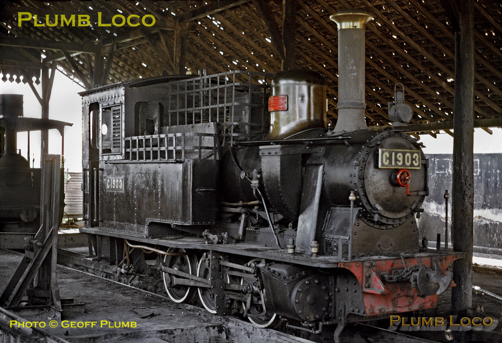 PNKA No. C19 03 is one of the twelve members of the class of short wheelbase outside cylindered 0-6-0Ts built by Hartmann between 1898 and 1902. It proudly carries its maker's plate on the polished brass dome, proclaiming it to be works No. 2421 of 1898. It is sitting inside the shed (more of a roof on stilts!) at Djati depot in Probolinggo. On the left is No. B16 24, an 0-4-0Tr (tram engine) possibly built by Hohenzollern, though I can find no reference for this engine! Friday 27th July 1973. Thanks to information received from Rob Dickinson, I now know that this loco is Hohenzollern No. 1190 of 1899, though not sure why it became B16 24 as opposed to B16 13, the next in the series... Slide No. 11938.