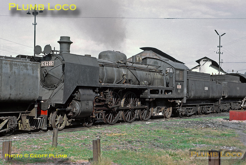 Four cylinder compound 4-6-2 No. C53 05 looks as though it has seen recent use but is now sitting dead on shed at Madiun. This is one of the first batch of twelve engines built by Werkspoor in 1917 (Works No. 396), a further batch of eight were built in 1921-22. Wednesday 25th July 1973. Slide No. 11812.