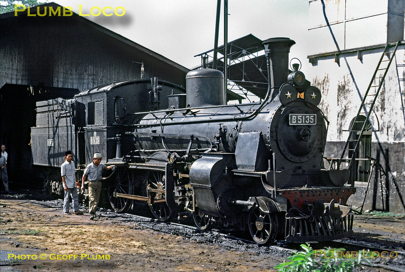 "PNKA Class B51 2 cylinder compound 4-4-0 No. B51 35 (with the tender from B51 19) is prepared by its crew for a train from Tanahabang to Rangkasbetung in West Java later the same day. 39 engines of this class were built by Hanomag, Hartmann & Werkspoor between 1900 and 1909, this engine being built by Werkspoor in 1907, Works No. 180. They were basically Prussian P4s scaled down to 3' 6"" gauge. The engines at Tanahabang depot in the suburbs of Djakarta were oil-burners, but many engines were wood-burners. Tuesday 17th July 1973. Slide No. 11130."