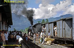 PNKA DD52 class 2-8-8-0 Mallet No. DD52 03 is en route from Tjibatu toTasikmalaja with a short freight train - though there are plenty of passengers on board. The train has just arrived in the station at Malangbong, to be met by a crowd of people, now unloading or loading their goods. Thursday 19th July 1973. DD52 03 was built by Hanomag in 1923, works No. 10223. Slide No. 11299.