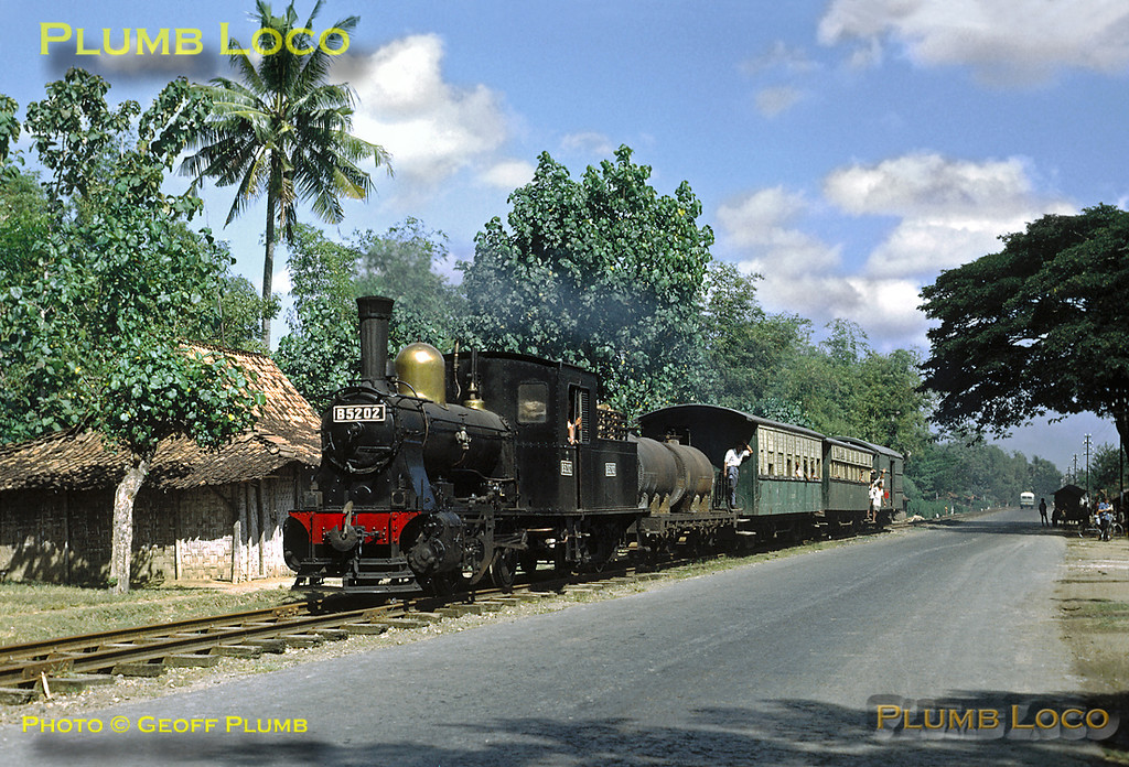 "B52 class 0-4-0 No. B52 02 is working the main train of the day, the 07:18 from Kudus to Rembang along the roadside section of the line not far from Rembang, exact location not known. The track can hardly be described as ""permanent way""! Monday 23rd July 1973. Slide No. 11676."