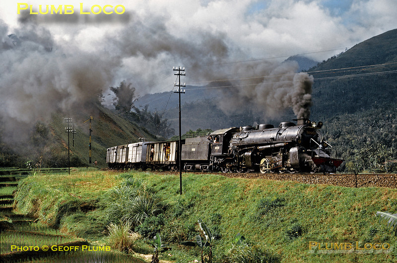 PNKA (Indonesian State Railways) DD52 Class 2-8-8-0 Mallet No. DD52 03 works a mixed goods train from Tjibatu to Tasikmalaja, approaching Tjipeundeuj in the mountains of south western Java on the afternoon of Thursday 19th July 1973. This engine was built by Hanomag in Germany in 1923. Slide No. 11313.