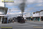 PNKA Class B50 2-4-0 No. B50 11 trundles along the main street in Madiun with a mixed train for Slahung, adding somewhat to the already chaotic nature of the traffic, though the local population seem to take it in their stride! This was the 14:15 departure from the main station. Tuesday 24th July 1973. Slide No. 11773.