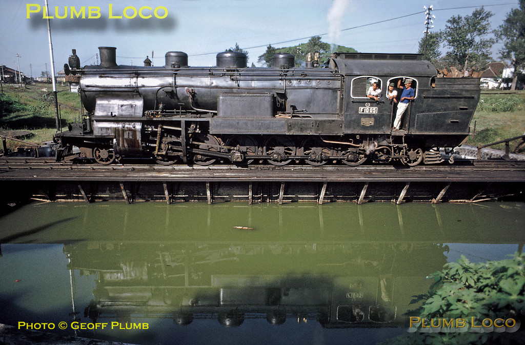 One of the remarkable 2-12-2Ts of Class F10, No. F10 05, has just arrived at Malang with the 04:00 mixed train from Blitar and is now on the turntable (or is it the water table?) at the depot on the morning of Thursday 26th July 1973. This engine was built by Hanomag in 1913. Slide No. 11887D.